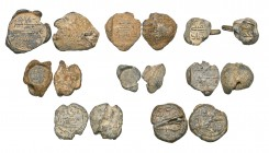 A COLLECTION OF EIGHT EARLY ISLAMIC LEAD SEALS, Umayyad and later, comprising: Umayyad, uniface (12.62g), undated, the three-line legend reading jalaj...