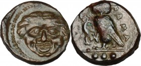 Sicily. Kamarina. AE Tetras, 425-405 BC. D/ Gorgoneion. R/ Owl standing left, head facing, wings closed, holding lizard; in exergue, three pellets. CN...