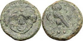 Sicily. Kamarina. AE, 425-405 BC. D/ Gorgoneion. R/ Owl standing left; holding lizard; in exergue, three pellets. CNS III, 21. AE. g. 3.14 mm. 14.00 V...