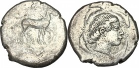 Sicily. Syracuse. Second Democracy (466-405 BC). AR Tetradrachm. D/ Quadriga right; above, Nike. R/ Head of Arethusa right, surrounded by four dolphin...