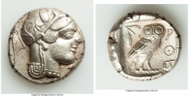 ATTICA. Athens. Ca. 465-455 BC. AR tetradrachm (25mm, 17.06 gm, 2h). AU. Head of Athena right, wearing crested Attic helmet ornamented with three laur...