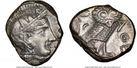 ATTICA. Athens. Ca. 393-294 BC. AR tetradrachm (23mm, 8h). NGC XF, brushed. Head of Athena right, wearing crested Attic helmet ornamented with three l...