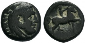 Macedonian Kingdom. Philip II. 359-336 B.C. AE unit . Head of young Herakles right, wearing lion skin headdress / ΦΙΛΙΠΠΟΥ, youth brandishing whip on ...