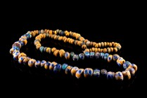 Celtic Mosaic Eye Bead Necklace, c. 6th-5st century BC. Spherical glass beads in blue, yellow and green with concentric ring detail. Modern wire.