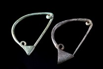 Lot of 2 Greek Bronze Fibulae, c. 5th-4th century BC (6.3-6.4cm). Toga brooch with triangular catch. Green patina, intact.