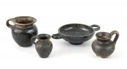 Collection Of Four Hellenistic Black -Glazed miniature Vessels, 4th century BC; height max cm 8, diam max cm 12. Provenance: English private collectio...