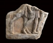 Roman Marble Slab With a Horse Rider, 1st - 3rd century AD; length cm 18. Provenance: Private collection, York.