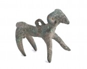 Greek Archaic Bronze Ram-Shaped Pendant, 7th - 6th century BC; length cm 5,5. Provenance: English private collection.