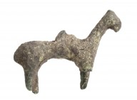 Greek Archaic Bronze Horse-Shaped Pendant, 7th - 6th century BC; length cm 4,5. Provenance: English private collection.