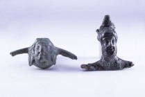 Couple of Roman Bronze Handle Appliques, 1st century BC - 2nd century AD; length cm 4,4 and cm 5,4; A theatrical mask and a Dionysos head. Provenance:...