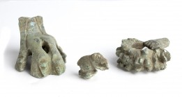 Collection of Three Roman Bronze fragmentary Figures, 1st-3rd century AD; length max cm 5. A lion's paw, and mouse and a hand holding wreath. Provenan...