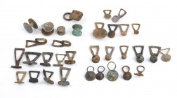 Collection of Thirtythree Roman Bronze Buttons, 1st - 4th century BC; length cm 1,5 to cm 3,5. Provenance: English private collection, acquired by the...