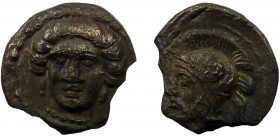 Greek, Cilicia, c. 380-370 BC, AR Obol, Tarsos 0.60 g, 9 mm, aF, toned  Obverse: Facing female head turned slightly left, wearing single-pendant earri...
