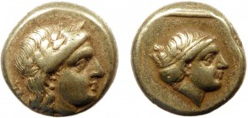 Greek, Lesbos, c. 377-326 BC, EL Hekte, Mytilene  2.54 g, 11 mm, VF  Obverse: Laureate head of Apollo right; symbol in left field Reverse: Head of Art...