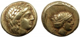 Greek, Lesbos, c. 377-326 BC, EL Hekte, Mytilene  2.54 g, 11 mm, VF  Obverse: Laureate head of Apollo right Reverse: Head of Artemis right, hair in sa...
