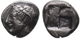 Greek, Ionia, c. 600-500 BC, AR Trihemiobol, Phokaia. Obverse: Female head left, in helmet or close fitting cap Reverse: Quadripartite incuse square R...