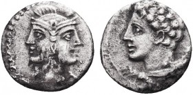 Greek, Cilicia, c. 4th Century BC, AR Obol, uncertain . Obverse: Janiform head of Athena Reverse: Bust of young Herakles left, lion skin tied around n...