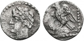 Greek, Cilicia, c. 4th Century BC, AR Obol, uncertain . Obverse: Youthful male head left, wearing grain wreath Reverse: Eagle left on lion's back, all...