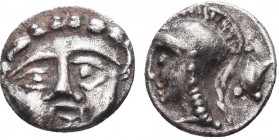 Greek, Pisidia, c. 350-300 BC, AR Obol, Selge . Obverse: Facing gorgoneion with protruding tongue Reverse: Helmeted head of Athena left, astragalos be...