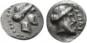 """Greek, Cilicia, c. 420-380 BC, AR Obol, Nagidos  Obverse: Head of Aphrodite right, hair in a sphendone Reverse: NAΓIΔEΩN, head of Dionysos right, wre..."