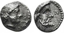 """Greek, Cilicia, c. 390-380 BC, AR Obol, Nagidos  Obverse: Head of Aphrodite right, hair in a sphendone Reverse: N, head of bearded Dionysos right Ref..."