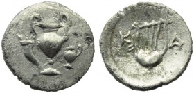 Apulia, Canusium, Obol, c. 300-250 BC; AR (g 0,52; mm 16; h 6); Cantharus between cornucopiae and oinochoe, Rv. Lyre; on l., K; on r., A. HNItaly 657....