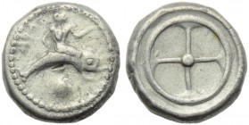 Apulia, Tarentum, Nomos, c. 500-480 BC; AR (g 8,03; mm 19; h 12); TΑΡΑΣ (retrograde), oecist riding dolphin l.; below, shell, Rv. Wheel with four spok...