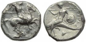 Apulia, Tarentum, Nomos, c. 332-302 BC; AR (g 7,72; mm 19; h 6); Horseman galloping r., holding shield and spears; below, ΔΑΙ, Rv. ΤΑΡΑΣ, oecist ridin...