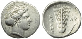 Lucania, Metapontion, Stater, c. 400-340 BC; AR (g 7,74; mm 23; h ; Head of Demeter r., hair bound in sakkos, wearing earrings and necklace; on l., KP...