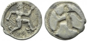 Bruttium, Caulonia, Obol, c. 525-500 BC; AR (g 0,49; mm 10; h 12); KAV (retrograde), daimon running l., head r., holding branch, Rv. Same type incuse....