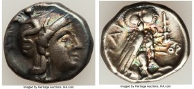 CALABRIA. Tarentum. Ca. early 3rd century BC. AR drachm (15mm, 3.23 gm, 12h). VF. Ca. 302-280 BC, Ior- magistrate. Head of Athena right, wearing crest...