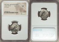 LUCANIA. Metapontum. Ca. 340-330 BC. AR nomos or stater (22mm, 7h). NGC VF. Veiled head of Demeter right, wearing barley wreath and pendant earring; Φ...