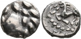 CELTIC, Central Europe. Vindelici. Mid 1st century BC. Quinarius (Silver, 12 mm, 1.26 g, 12 h), 'Büschelquinar' type. Celticized male head to left. Re...