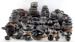 A collection of black-glazed ceramics