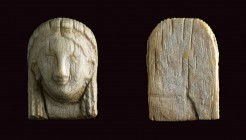 Small Ivory plaque in shape of Kore head