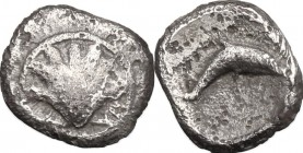 Greek Italy. Southern Apulia, Tarentum. AR Hemilitron, 325-280 BC. D/ Shell. R/ Dolphin right. HN Italy 980. AR. g. 0.33 mm. 8.00 Toned. VF/About VF.