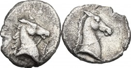 Greek Italy. Southern Apulia, Tarentum. AR 3/4-obol, 325-280 BC. D/ Head of horse right, bridled. R/ Head of horse right, bridled. HN Italy 981. AR. g...