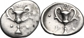 Greek Italy. Southern Apulia, Tarentum. AR Obol, c. 280-228 BC. D/ Kantharos; five pellets around. R/ Kantharos; four pellets around and rosette above...