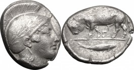 Greek Italy. Southern Lucania, Thurium. AR Stater, 443-400 BC. D/ Head of Athena right, wearing helmet decorated with wreath. R/ Bull butting left; in...
