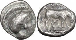 Greek Italy. Southern Lucania, Thurium. AR Diobol, 400-370 BC. D/ Head of Athena right, wearing helmet decorated with wreath. R/ Bull butting right; i...