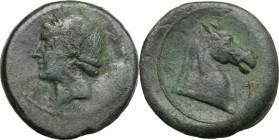 Greek Italy. Bruttium, Carthaginians in South-West Italy. AE Unit, 215-205 BC. D/ Head of Tanit left, wearing wreath. R/ Head of horse right; before, ...