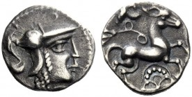 Celtic Coins   The Aulerci Cenomani (East and Central Gaul)  Minimus circa 80-50, AR 1.18 g. Helmeted head of Athena r. Rev. Horse prancing r.; below...