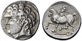 Celtic Coins   Uncertain tribe (Central Europe)  Tetradrachm imitating Philip II issue 2nd-1st century BC, AR 12.59 g. Stylised male head l.  Rev.  C...