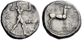 Greek Coins   Caulonia  Nomos circa 475-470, AR 8.32 g. Naked Apollo standing r.; in r. field, stag with head turned back. Rev. Stag standing r.; in ...