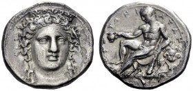 Greek Coins   Caulonia  Nomos circa 400-325, AR 7.63 g. Head of Hera Lacinia facing, wearing decorated stephane. Rev. Young Heracles seated l. on lio...