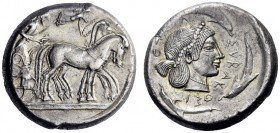 Greek Coins   Syracuse  Tetradrachm circa 480-475, AR 17.13 g. Slow quadriga driven r. by charioteer, holding kentron and reins; above, Nike flying r...