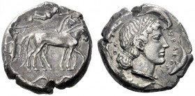 Greek Coins   Syracuse  Tetradrachm circa 460-440, AR 16.43 g. Slow quadriga driven r. by charioteer, holding kentron and reins; above, Nike flying r...