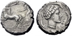 Greek Coins   Syracuse  Tetradrachm circa 440-430, AR 17.04 g. Prancing quadriga driven l. by charioteer, holding kentron and reins; above, Nike flyi...