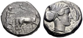 Greek Coins   Syracuse  Tetradrachm circa 430-420, AR 17.23 g. Slow quadriga driven r. by charioteer, holding kentron and reins; above, Nike flying l...