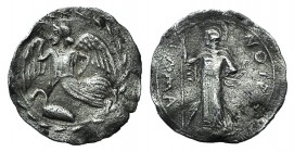 Sicily, Kamarina, c. 461-440/35 BC. AR Litra (11mm, 0.41g, 8h). Nike flying l.; below, swan standing l.; all within wreath. R/ Athena standing l., hol...